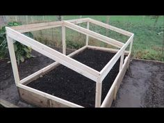"Make a frame on hinges like this for carrot bed.  Cover with ""fixed"" mesh to protect from white fly."