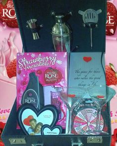 """Zotorius Creations Gift Baskets, LLC - """"Like"""" us on Facebook! This basket consist of The Great British Cocktail Hamper (martini shaker, 2 martini glasses, strainer & spirit measure); a game called Sybarit (for 2 to 8 adults, seeking fine moments in life); 750ml of Strawberry Irresistible Tequila Rose strawberry creme with two shot glasses; Spin the Bottom Button a romance game for two and other decorative items that compliments this basket. Tequila Rose, Board Games For Couples, Rose Basket, Great British, Hamper, Gift Baskets, Valentine Gifts, Decorative Items, Martini"""