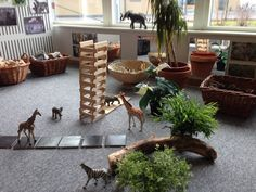 Loose parts, mirrors, blocks, toy animals, plants, baskets on the floor- click on image for better view ≈≈ http://www.pinterest.com/kinderooacademy/provocations-inspiring-classrooms/