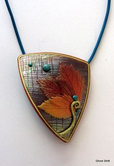 Autumn Leaf Pendant by Sue Corrie/Ghost Shift. - like the layering and the texture of the background