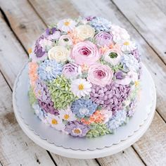 Buttercream wedding cake covered in flowers by Indonesian cake maker @ivenoven