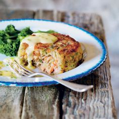 Deep trout fish cakes with lemon butter & chive sauce makes a delicious midweek meal idea. Taken from The Great British Farmhouse Cookbook