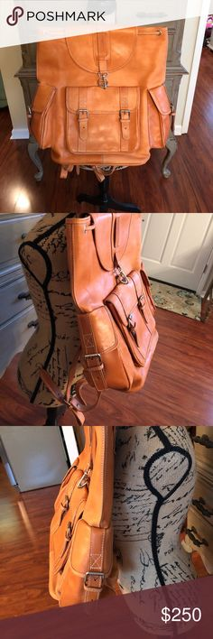 "Leather backpack  % Leather backpack purchased out of country. BEAUTIFUL leather with lots of pockets with buckles that do work. Used for travel a few times. Widest point is 18"" across and approximately 18"" up and down. Bags Backpacks"