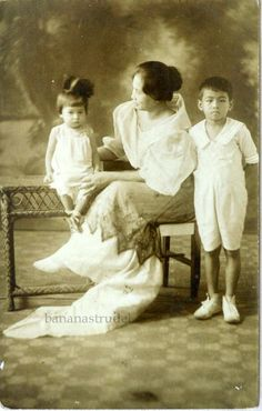 Lady with two young children. Manila, 1930s