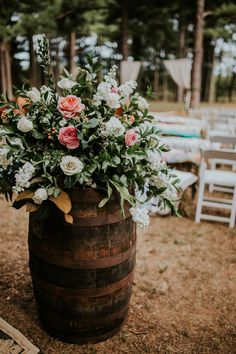 This ranch wedding in Oklahoma features cozy ceremony décor details like vintage brass, crocheted afghans, and mismatched area rugs.