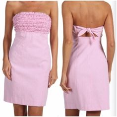 """LILLY PULITZER Pink Franco Dress Lilly Pulitzer Pink Seersucker Franco Dress. Strapless dress in vintage cotton seersucker features a fiercely feminine ruffled bodice.Fitted silhouette shows off curves. -Empire waistband emphasizes the bust. -Flirty tie back.  -Seamed skirt.  -Side zip.  -Falls above the knee.  -Fully lined.  -30""""length. -Shell Lining: 100% cotton.  -Excellent condition!  NO Trades. Please make all offers through offer button. Lilly Pulitzer Dresses Strapless"""