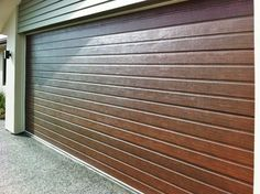 insulated roll up garage doorsContemporary Wood Garage Door with Architectural Metal inlay