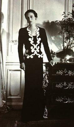 """""""Wallis in Schiaparelli's carbon blue silk jersey dress and jacket embroidered with baroque gilded scrolls."""" from 'The Windsor Style' by Suzy Menkes"""