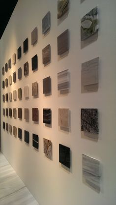 KBIS Antolini Luigi's booth displayed only a glimpse of the high quality natural stones he offers! Showroom Interior Design, Showroom Ideas, Tile Showroom, Wall Shelving Units, Display Shelves, Shop Interiors, Office Interiors, Property Ad, Resource Room