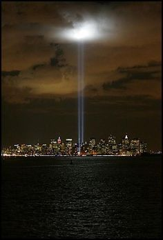 Remembering 9/11/2001.  The lights shining into heaven, the heart shape in the clouds, touching. | Shared by LION