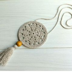 Бижу в стиле бохо. Хлопок, лен, деревянная бусина. Длина шнурка 36см, диаметр медальона 9см, длина кисти 8см. Цена 120грн.  #украшенияручнойработы #бохобижу #бохо #бохостиль #bohostyle #boho #bohojewelry