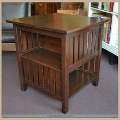 L&JG Stickley Book Table in very good condition with an excellent new finish to top. Measure 29″ tall x 26 1/2″ square.