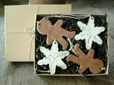 Pottery Christmas Ornaments- You Pick Four: Snowflake, Star, Gingerbread Man.  Each one is cut out of stoneware clay, glazed, fired to over 2100° F, and tied with twine.