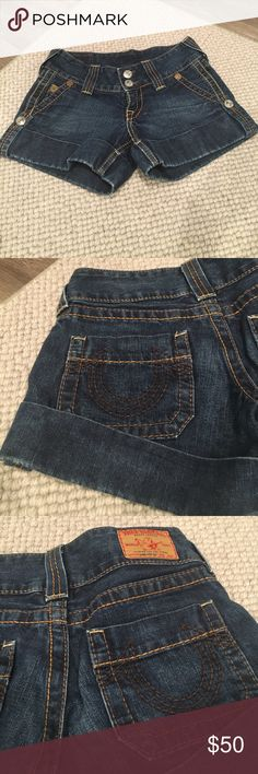 True Religion Cuffed Jean Shorts Cuffed jean shorts with side snap detail and horseshoe stitch detail on back pockets. 2 inch inseam. Size 25. True Religion Shorts Jean Shorts