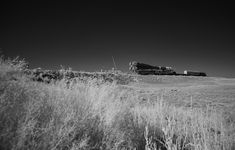 In this black and white infrared image, the Soyuz rocket is seen as it transported to the launch pad by train, Thursday, July 18, 2019 at the Baikonur Cosmodrome in Kazakhstan.