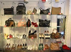 This consignment shop is OOB now, but never mind. I wanted to show you how MUCH more interesting a wall of handbags AND shoes looks. Why separate, TGtbT.com says, when they look so much more enticing together? (Also note the pair with the shoe box...)
