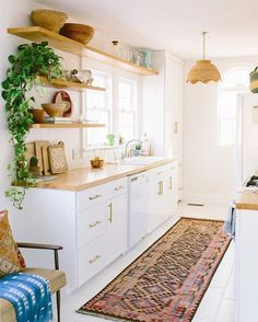 Love the contrast of brass hardware against white cabinet. #kitchendesign