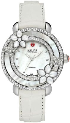 MWW20A000002  NEW MICHELE CLOETTE FLEUR LADIES WATCH IN STOCK   - FREE Overnight Shipping | Lowest Price Guaranteed    - NO SALES TAX (Outside California) - WITH MANUFACTURER SERIAL NUMBERS- White Mother of Pearl Dial  - 122 Diamonds Set on Bezel (0.64ct)  - Battery Operated Quartz Movement- 3 Year Warranty- Guaranteed Authentic  - Certificate of Authenticity- Manufacturer Box