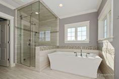 Contemporary Master Bathroom with Handheld showerhead, Freestanding, frameless shower door - looks peaceful