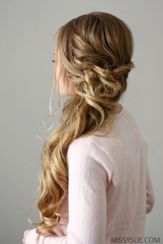 New Years Eve is nearly here and this side swept dutch braid would be the perfect party look! Whether you're going out to dinner with that special someone or dancing the night away, this look is glamorous yet effortless with its bouncy curls and peek-a-boo braid. Pair it with a bold lip and glittery gown for a look that is sure to be a favorite amongst the crowd. Side Swept Dutch Braid Supplies: Teasingbrush Tangle Ease brush 10-12 bobby pins 1″ curling iron Firm-hold hairspray Side Swept…