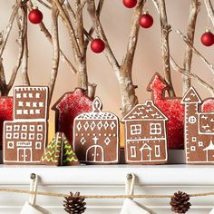 Use cute house-shape cookie cutters to cut a display from gingerbread cookie dough. Bake the dough until the edges are lightly browned; let cool completely. Use icing to outline windows, doors, and more to complete the village-scape. Let the cookie harden and put together for a mantel-ready display that lasts the season.