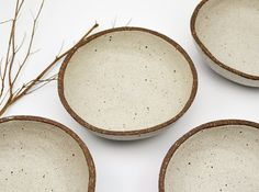 This listing is for one rustic bowl that has been hand formed, by me, from earthy, textured stoneware clay. After bisque firing it has been selectively glazed to create a beautiful contrast between the soft white glaze and the raw clay. Then it has gone back into the kiln and high fired to give it strength and durability. Height 5cm (2) Diameter 16cm (6)  In many of my ceramic pieces you will find slight imperfections and marks left by the handmade process. These contribute to the…