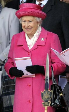 QUEEN ELIZABETH II'S ROYAL STYLE THROUGH THE YEARS 2015 Pink for a princess! The Queen stepped out in a rose-colored hat and coat just hours after the birth of her great-grandaughter Charlotte.