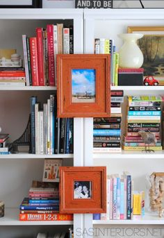 Styled bookcases...I like the frames on the outside of the dividers on the bookcase