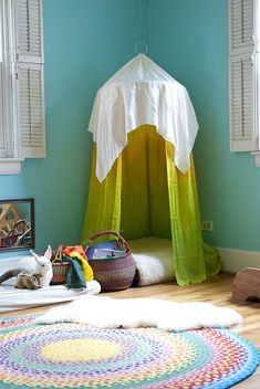 A fun fort made from a hula hoop and fabric!!
