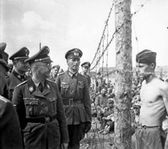 """Himmler inspects a prisoner of war camp on the Eastern Front.   In the spring of 1934, when Heinrich Himmler had already taken over the control of the concentration camps, the SS received full control over the camps on 4 July 1934 after the elimination of the SA (Night of the long knifes). Himmler made Theodor Eicke, commanding officer of the Concentration Camp in Dachau, established on 20 March 1933. He was promoted to """"Inspekteur der Konzentrationslager"""""""