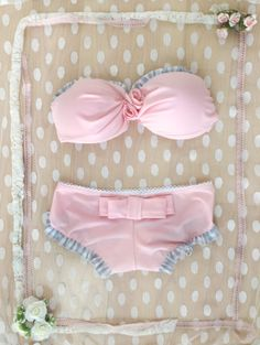 With a lovely BOW on the back & two ROSES on the front...      This is our NEW BIKINI... Tres Jolie!!!!!!!!!  * Available in 8 colors