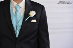 Black suit and Tiffany Blue vest and tie for the groom