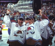 Ray Bourque and Joe Sakic raise the cup in 2001
