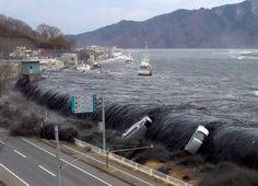 Massive tsunami climbing over a dike of Miyako-shi, Iwate
