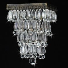 This glamorous flush mount ceiling light will add sparkle to any room in your home. It features teardrop-shaped crystals, which will reflect patterns of light as soon as you flip the switch, and it has a rustic antique copper finish for added beauty.