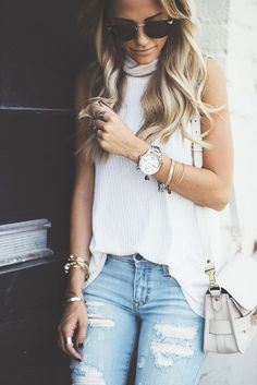 Stacked jewelry & distressed jeans.