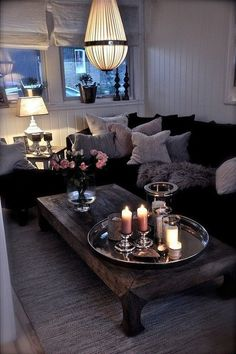 Love the vibe and  lighting in here, including the candle grouping on the coffee table.