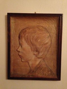 "Wood carving by Norwegian sculptor Valentin Axel Kielland (1866-1944): ""Arbeidergutt"" (boy worker) dated 1904.  Kielland was educated in Paris where he shared an appartment with Edvard Munch.  In the period 1903-05, while running a school for sculpture and wood carving in Kristiania (now Oslo), he carved a series of very sensitive portraits.  Valentin Kielland is first cousin of the painter Kitty Kielland and the writer Alexander Kielland."