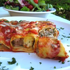 This Spicy Sausage Manicotti is sure to light up your taste buds! #premiofoods