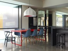 Love the mix of the Red Table, Wishbone Chair & Grey Eames Chairs