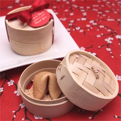 Favors of mini bamboo steamers filled with fortune cookies