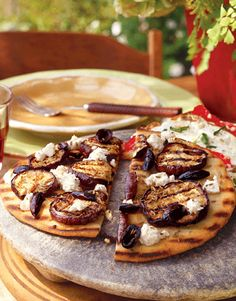 When there is no time to make dough, serve pizza toppings on flat bread. Try our Greek-inspired version or create your own quick pizza.
