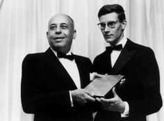 Stanley Marcus presenting Saint Laurent with  the Neiman Marcus fashion award in 1958.