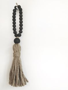 """Give your guests a wordless welcome with a fun beach hippie welcome tassel!About this Welcome Tasel:Hangs approx. 17"""" longHand made jute tasselTassel - 7-8""""Wooden Beads - Mo..."""