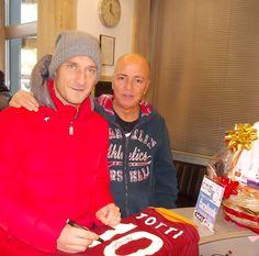 Francesco Totti e Luciano Bellotti parrucchiere.