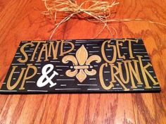 """SALE New Orleans Saints """"Stand Up and Get Crunk"""" Black and Gold Fleur de Lis Hand Painted Wood Hanging Sign. $20.00, via Etsy."""