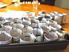 Newspaper seed starting pots (homemade.) Plant the entire thing, the newspaper will decompose as the plant grows.