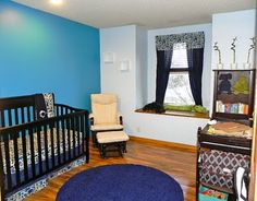 recessed lights/canned lights in... modern zoo nursery #baby #boy - chair has been recovered to match the rest of the nursery. art work also added to the walls.