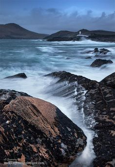 Wild Atlantic Ocean at Valentia Island is one of Ireland's most westerly points lying off the Iveragh Peninsula in SW of County Kerry.  It is linked to the mainland by the Maurice O'Neill Memorial Bridge at Portmagee, Ireland.