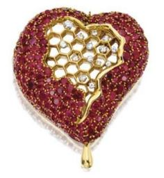 "Ruby and diamond ""Honeycomb Heart"" brooch and matching earrings sold at Sotheby's in 2006"